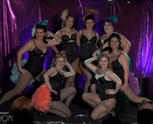 women dancing in bustles